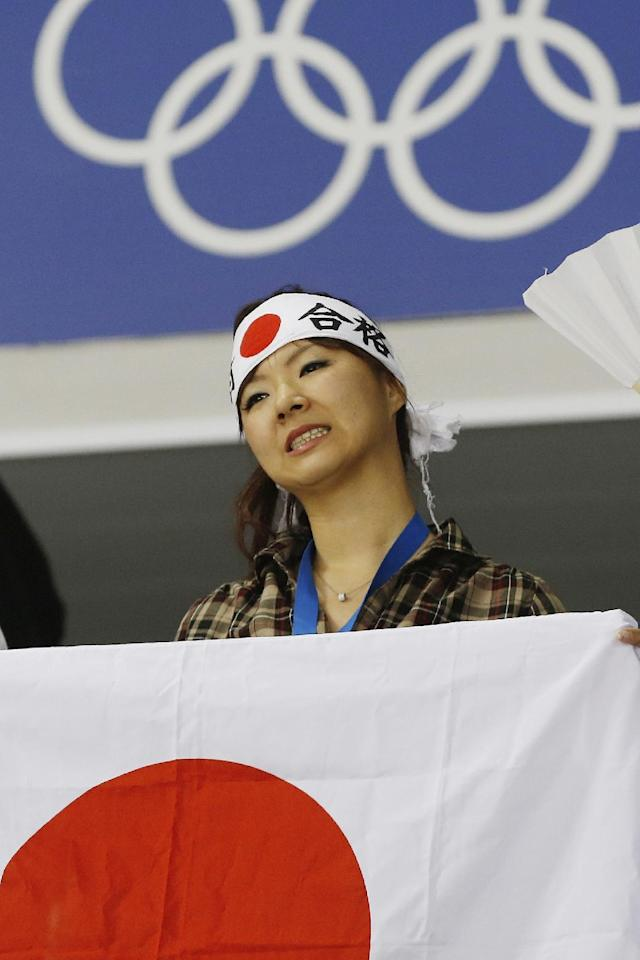 A Japanese fan reacts to the 4-0 loss to Germany during the 2014 Winter Olympics women's ice hockey game at Shayba Arena, Thursday, Feb. 13, 2014, in Sochi, Russia. (AP Photo/Petr David Josek)
