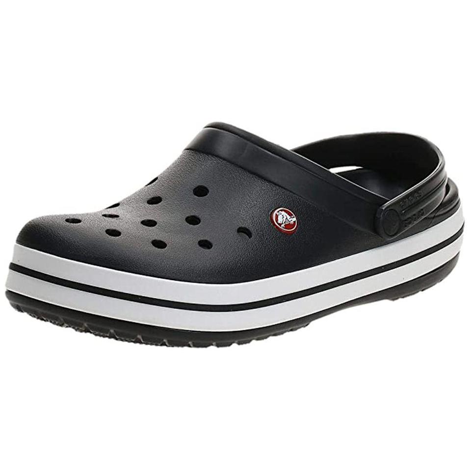 """<p><strong>Crocs</strong></p><p>amazon.com</p><p><strong>$49.99</strong></p><p><a href=""""https://www.amazon.com/dp/B002LITTDI?tag=syn-yahoo-20&ascsubtag=%5Bartid%7C2089.g.1453%5Bsrc%7Cyahoo-us"""" rel=""""nofollow noopener"""" target=""""_blank"""" data-ylk=""""slk:Shop Now"""" class=""""link rapid-noclick-resp"""">Shop Now</a></p><p>Crocs are <em>finally </em>having their moment as a fashion-centric foot option, thanks to collabs with Bad Bunny and others, and honestly, they're freaking comfortable. Even if Dad only wears them around the house, they are a game changing shoe.</p>"""