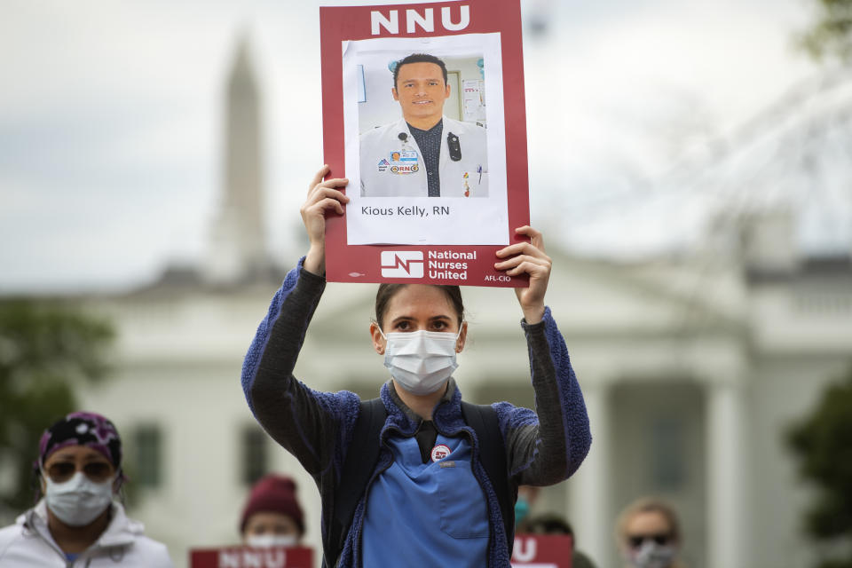 UNITED STATES - APRIL 21: Registered Nurses conduct a demonstration in Lafayette Park to read aloud names of health care providers who have contracted COVID-19 and died as a result of treating infected patients on Tuesday, April 21, 2020. The event was held by National Nurses United (NNU) to demand that health care workers be provided with the best personal protective equipment (PPE). (Photo By Tom Williams/CQ-Roll Call, Inc via Getty Images)