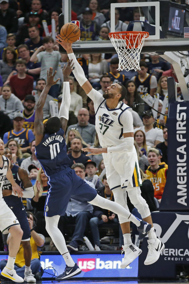 Utah Jazz center Rudy Gobert (27) defends against Dallas Mavericks forward Dorian Finney-Smith (10) in the second half during an NBA basketball game Saturday, Jan. 25, 2020, in Salt Lake City. (AP Photo/Rick Bowmer)