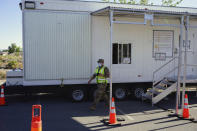 A Nevada National Guardsman leaves a portable trailer that the Federal Emergency Management Agency designed as mobile vaccination unit on May 18, 2021, in Fallon, Nev. It's one of several methods health officials are employing here and across the country to bring vaccines directly to people to counter waning demand. In tiny towns, ballparks, strip clubs, and marijuana dispensaries, officials are setting up shop and offering incentives to entice people who so far have not gotten shots. (AP Photo/Sam Metz)