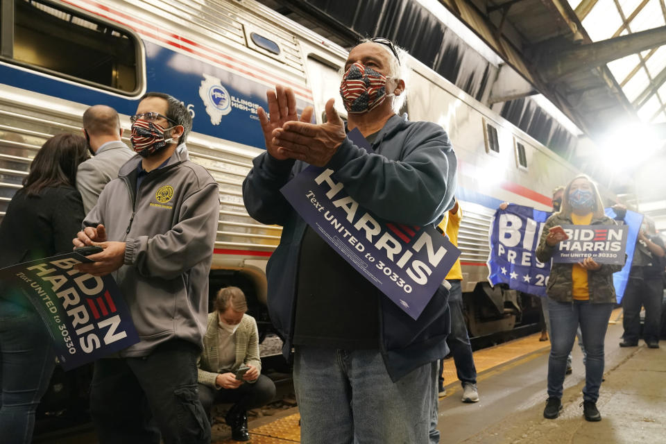 Supporters applaud as Democratic presidential candidate former Vice President Joe Biden speaks at Amtrak's Pittsburgh Train Station, Wednesday, Sept. 30, 2020, in Pittsburgh. Biden is on a train tour through Ohio and Pennsylvania today. (AP Photo/Andrew Harnik)