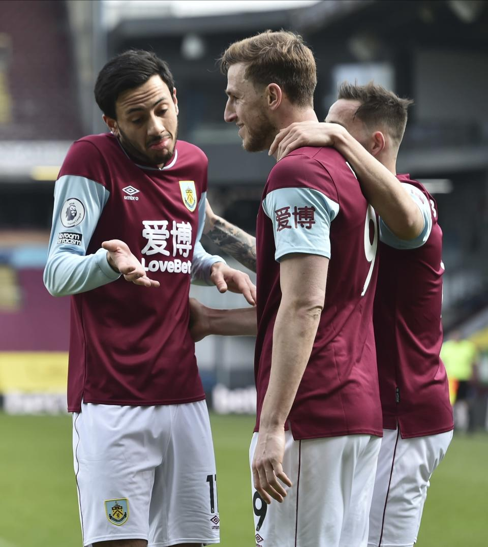 Burnley's Chris Wood, center, celebrates scoring his team's first goal during the English Premier League soccer match between Burnley and Arsenal at Turf Moor stadium in Burnley, England, Saturday, March 6, 2021.(Peter Powell/Pool via AP)