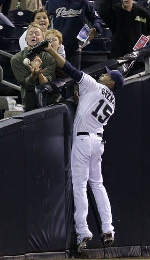 San Diego Padres outfielder Jesus Guzman can't make the catch off a foul ball hit by Miami Marlins' Donnie Murphy in the tenth inning during their baseball game Friday, May 4, 2012, in San Diego. (AP Photo/Gregory Bull)