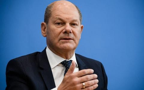 German Minister of Finance of the Social Democratic Party (SPD) Olaf Scholz gestures during a press conference with Member of the Landtag Brandenburg of the German Social Democratic Party (SPD) Klara Geywitz (not in the picture) on their candidacy for the office of SPD leadership at the Bundespressekonferenz in Berlin, Germany, 21 August 2019. - Credit: CLEMENS BILAN/EPA-EFE/REX