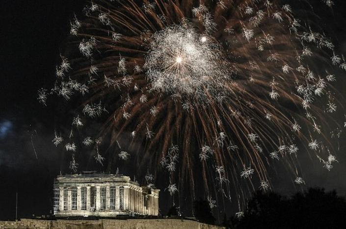 Fireworks explode over the ancient Acropolis in Athens during the new year's celebrations on December 31, 2020