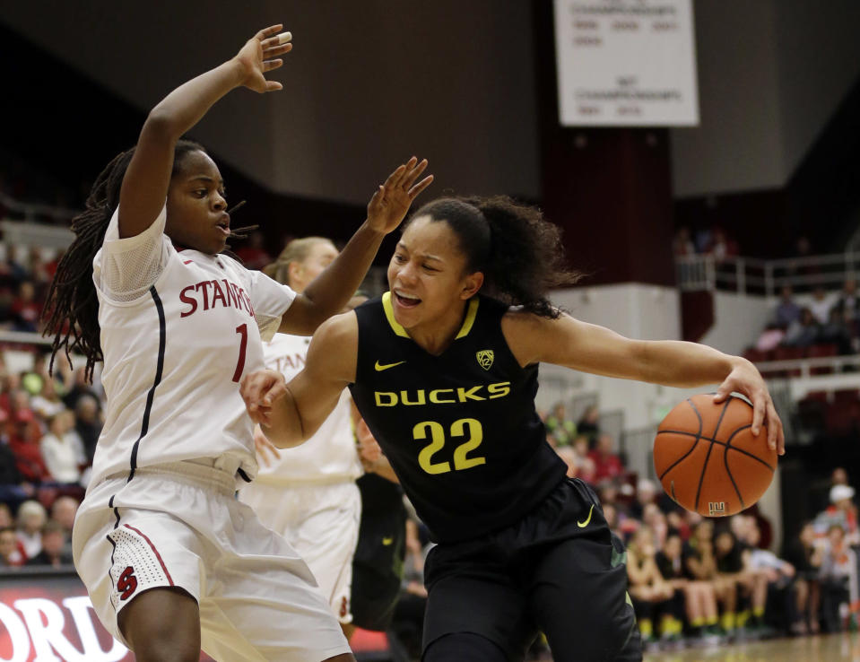 Oregon's Ariel Thomas (22), right, is defended by Stanford 's Lili Thompson (1) during the first half of an NCAA college basketball game on Friday, Jan. 3, 2014, in Stanford, Calif. (AP Photo/Marcio Jose Sanchez)