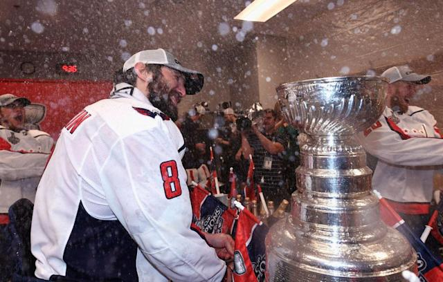 "<a class=""link rapid-noclick-resp"" href=""/nhl/teams/was"" data-ylk=""slk:Washington Capitals"">Washington Capitals</a> star <a class=""link rapid-noclick-resp"" href=""/nhl/players/3637/"" data-ylk=""slk:Alex Ovechkin"">Alex Ovechkin</a> spends some quality time with the Stanley Cup. (Getty Images)"