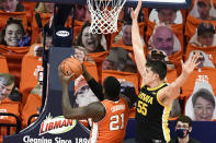 Iowa's center Luka Garza (55) looks to block the shot of Illinois center Kofi Cockburn (21) in the first half of an NCAA college basketball game Friday, Jan. 29, 2021, in Champaign, Ill. (AP Photo/Holly Hart)