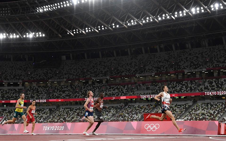 Jake Wightman is first to cross the line - AFP