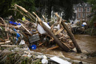 Debris collects in front of a bridge after flooding in Ensival, Verviers, Belgium, Friday July 16, 2021. Severe flooding in Germany and Belgium has turned streams and streets into raging torrents that have swept away cars and caused houses to collapse. (AP Photo/Francisco Seco)