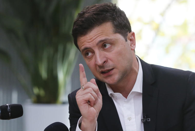 "Ukrainian President Volodymyr Zelenskiy speaks during talks with journalists in Kyiv, Ukraine, Thursday, Oct. 10, 2019. Ukrainian President is holding an all-day ""media marathon"" in a Kyiv food court amid growing questions about his actions as president. (AP Photo/Efrem Lukatsky)"