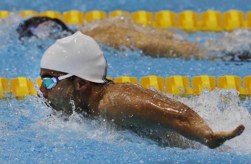 Brazil's Daniel Dias competes to win the gold medal and setting a new world record in the men's 50m butterfly S5 final at the 2012 Paralympics, Friday, Sept. 7, 2012, Dias was born with malformed upper and lower limbs and at the 2008 Summer Paralympics in Beijing had won a total of nine medals including four golds, more than any other athlete at the Games. (AP Photo/Lefteris Pitarakis)