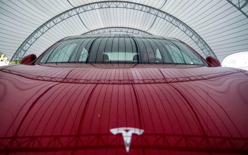 By Miles launches deal that syncs up to Tesla computers and is cheaper than traditional insurance - REUTERS