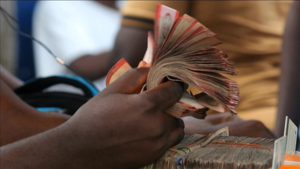 Fifteen Liberians including the son of former president Ellen Johnson Sirleaf are banned from leaving Liberia while the government investigates the whereabouts of $104 million in missing cash intended for the central bank. Julian Satterthwaite reports.