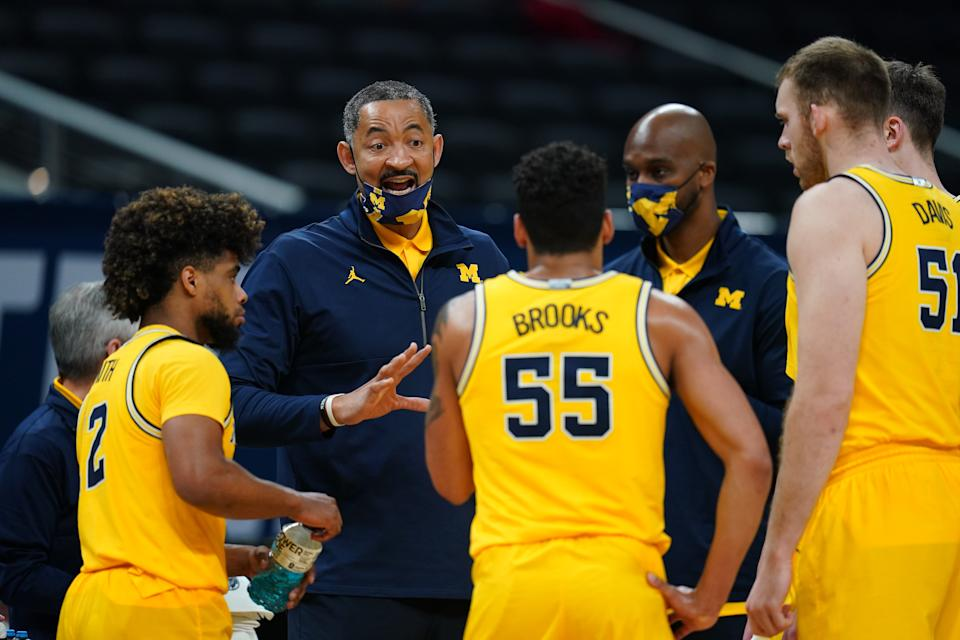 INDIANAPOLIS, IN - MARCH 28: Head coach Juwan Howard of the Michigan Wolverines  talks with players during a time out against the Florida State Seminoles in the Sweet Sixteen round of the 2021 NCAA Division I Mens Basketball Tournament held at Bankers Life Fieldhouse on March 28, 2021 in Indianapolis, Indiana. (Photo by Jack Dempsey/NCAA Photos via Getty Images)