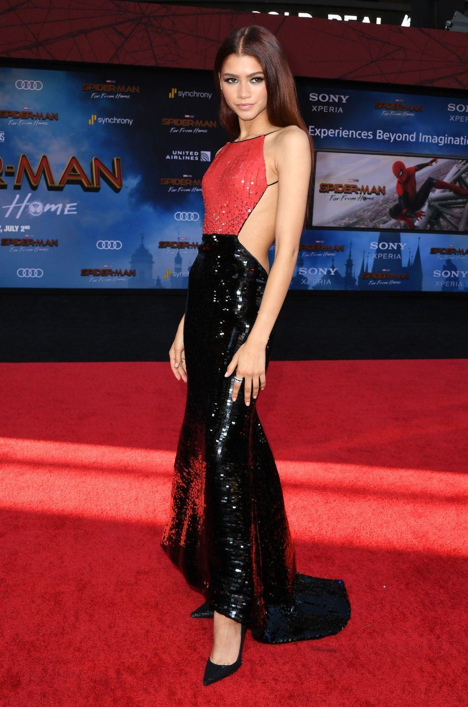 <p>She wore this hella chic interpretation of the Spider-Man suit to the <em>Spider-Man: Far From Home </em>premiere. The backless Armani Privé gown was just delightfully on the nose.</p>