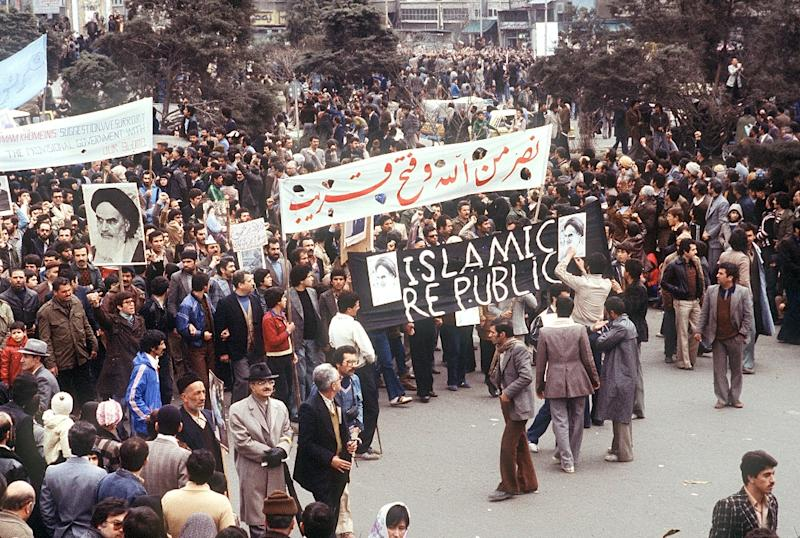 A demonstration in February 1979 in support of the government formed by Ayatollah Ruhollah Khomeini, with banners calling for an Islamic republic (AFP Photo/GABRIEL DUVAL)
