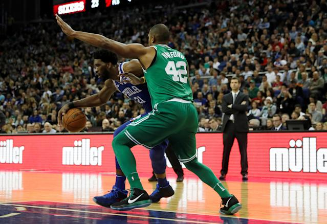 Basketball - NBA - Boston Celtics vs Philadelphia 76ers - O2 Arena, London, Britain - January 11, 2018 Boston Celtics' Al Horford in action with Philadelphia 76ers' Joel Embiid REUTERS/Matthew Childs