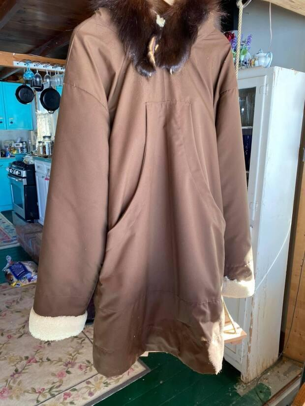 The parkas are lined with sheepskin and are sized for two adults and one child.