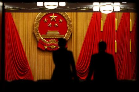 Delegates arrive to the third plenary session of the National People's Congress (NPC) at the Great Hall of the People to take a part in a vote on a constitutional amendment lifting presidential term limits, in Beijing, China March 11, 2018. REUTERS/Damir Sagolj