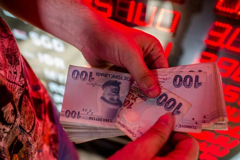 Turkey's currency dipped below eight lira to the dollar after trading at around 8.5, a record, one week earlier.