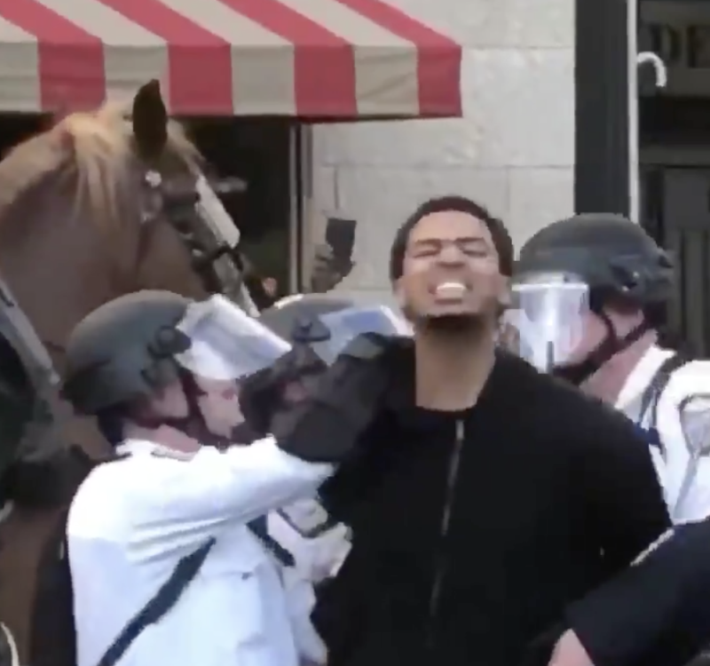 "Seth Towns continued to shout, ""Say his name!"" as Columbus police detained him. (Twitter)"
