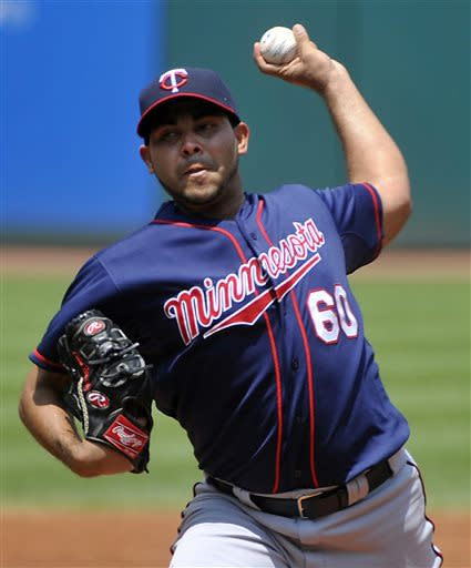 Minnesota Twins pitcher Pedro Hernandez delivers to Cleveland Indians' Michael Bourn during the first inning of a baseball game in Cleveland, Sunday, June 23, 2013. AP Photo/Phil Long)