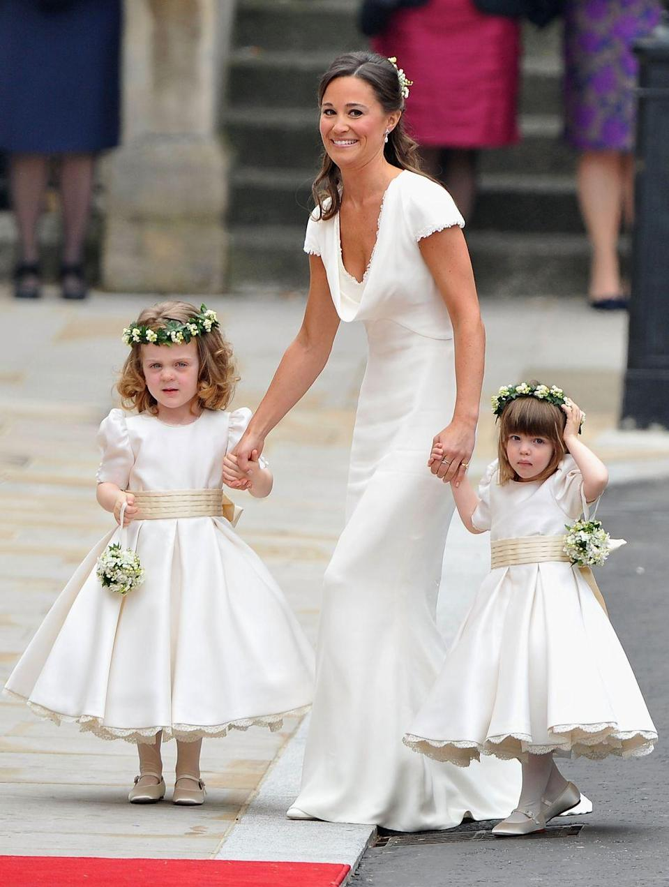<p>Pippa was a hot talking point on the day of the wedding, as a result of her Alexander McQueen by Sarah Burton gown and svelte physique (and yes, by that we mean her bottom).</p><p>'It is a bit startling to achieve global recognition before the age of 30 on account of your sister, your brother-in-law and your bottom,' the mother-of-one wrote in You magazine a year after the wedding. </p><p>Pippa's dress was made of an ivory, satin-based crepe. It had the same buttons and lace trims as the bride's dress.</p>