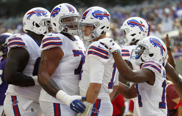 Bills quarterback Josh Allen (C) celebrates with teammates after scoring on a 10-yard TD run during the first half against the Vikings. (AP)