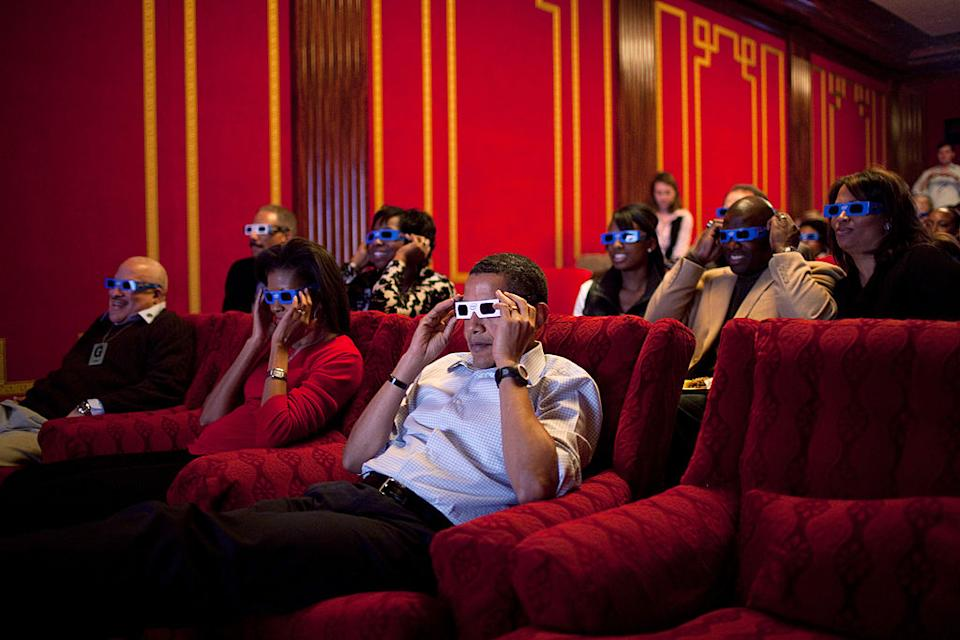 Pictured are Barack Obama and Michelle Obama wearing 3D glasses while watching Super Bowl 43 in the family theatre of the White House.