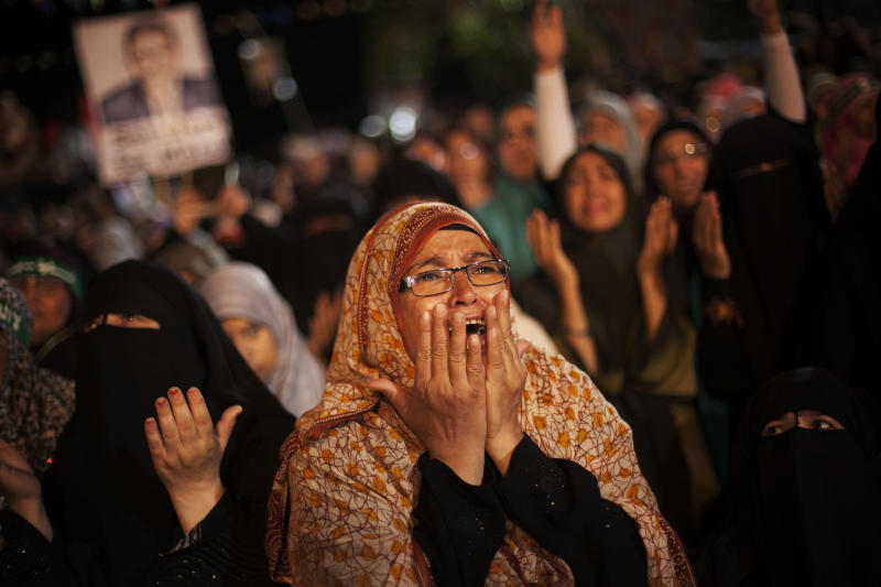 A supporter of Egypt's ousted President Mohammed Morsi cries during a protest against Egyptian Defense Minister Gen. Abdel-Fattah el-Sissi at Nasr City, where protesters have installed a camp and hold daily rallies, in Cairo, Egypt, Monday, July 29, 2013. (AP Photo/Manu Brabo)