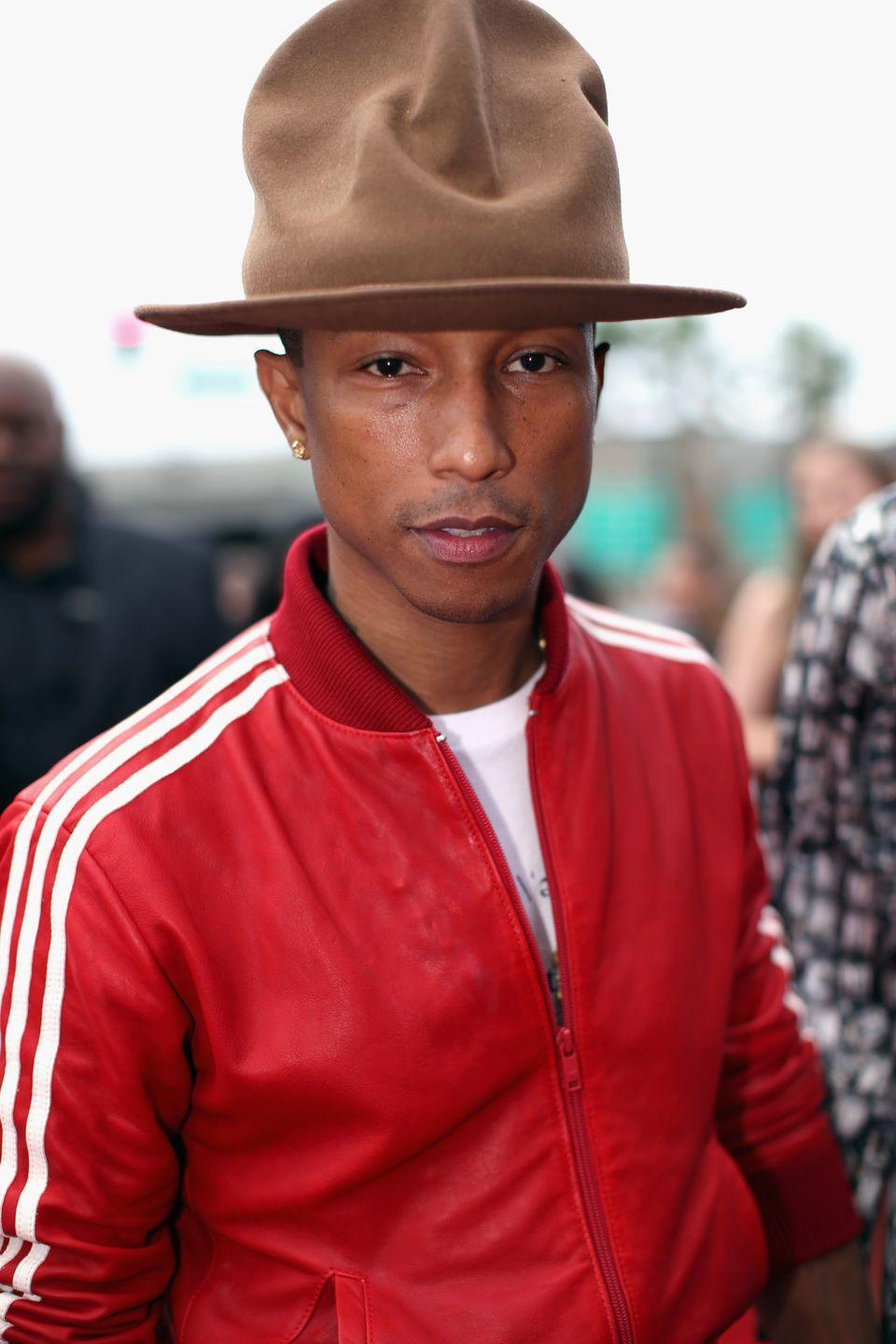 "<p>No matter where he goes, Pharell is rarely without his sky-high hat. The musician <a href=""https://www.gq.com/story/who-makes-pharrell-grammys-hat-brand"" rel=""nofollow noopener"" target=""_blank"" data-ylk=""slk:first sported"" class=""link rapid-noclick-resp"">first sported</a> the Vivienne Westwood topper at the 2014 Grammys, and now has a whole collection in different colors. The hat even has a <a href=""https://twitter.com/pharrellhat"" rel=""nofollow noopener"" target=""_blank"" data-ylk=""slk:parody Twitter account"" class=""link rapid-noclick-resp"">parody Twitter account</a>. </p>"