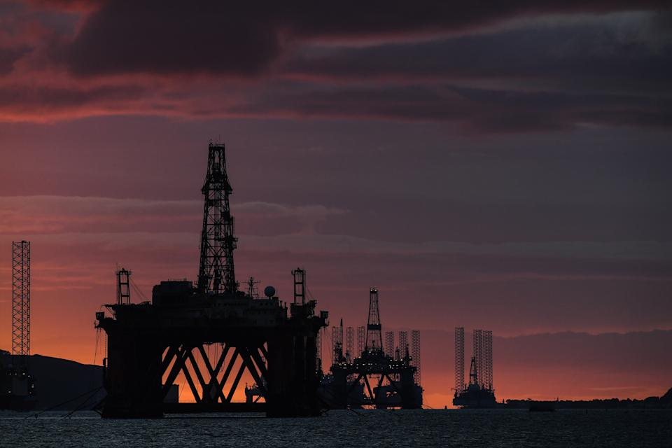 CROMARTY, SCOTLAND - SEPTEMBER 09: Oil rigs and drilling platforms are seen at sunrise on September 9, 2020 in Cromarty, Scotland. Complaints from locals have spiked over the past few months as the downturn in oil forced a significant increase in unused rigs being stored in the Cromarty Firth. Between May 19 and July 01 19 formal complaints were made, compared to five in the 10 months prior. Complaints relate to light and vibrations from the platforms with residents also complaining of hearing the tannoy systems used on the rigs. (Photo by Peter Summers/Getty Images)