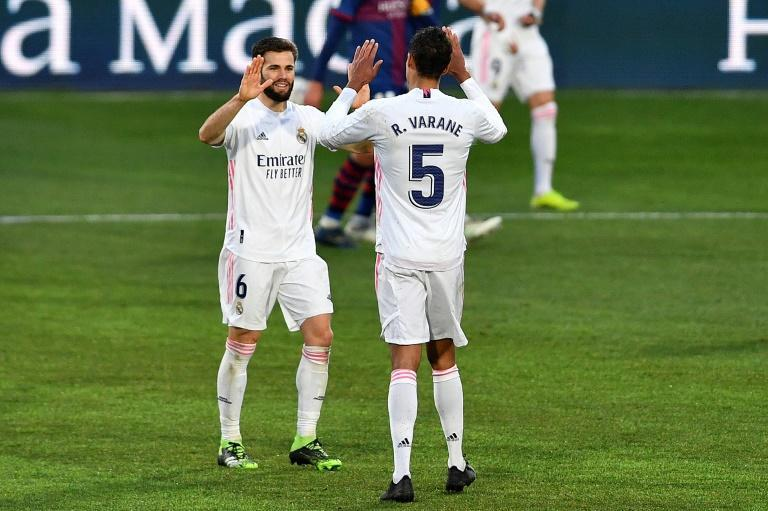 Real Madrid needed an unlikely double from Varane (R) to beat Huesca