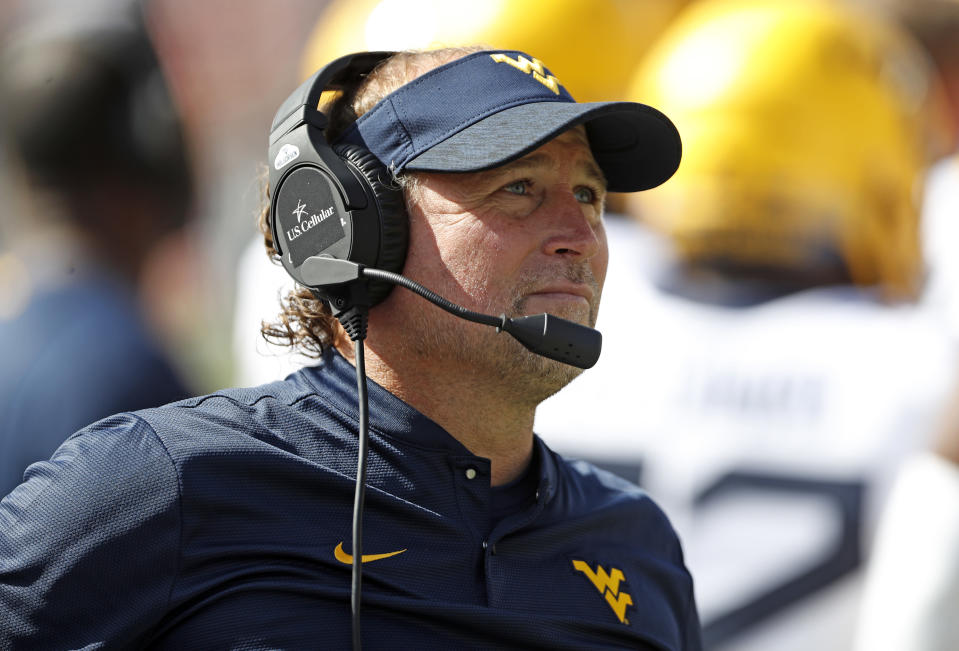 West Virginia's Dana Holgorsen would be returning to a more natural tie to his roots if he took the Buffaloes job. (AP)