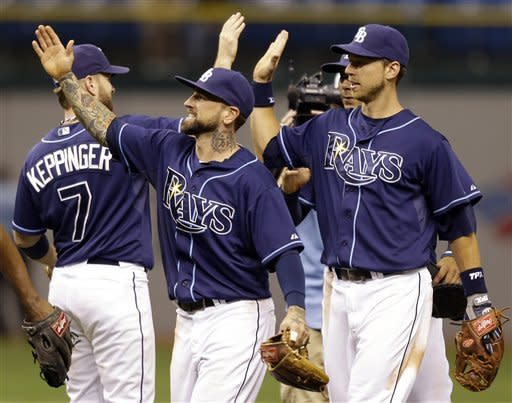 Tampa Bay Rays, from left, Jeff Keppinger, Ryan Roberts, and Ben Zobrist react after the team defeated the Kansas City Royals 5-3 in a baseball game Wednesday, Aug. 22, 2012 in St. Petersburg, Fla. (AP Photo/Chris O'Meara)