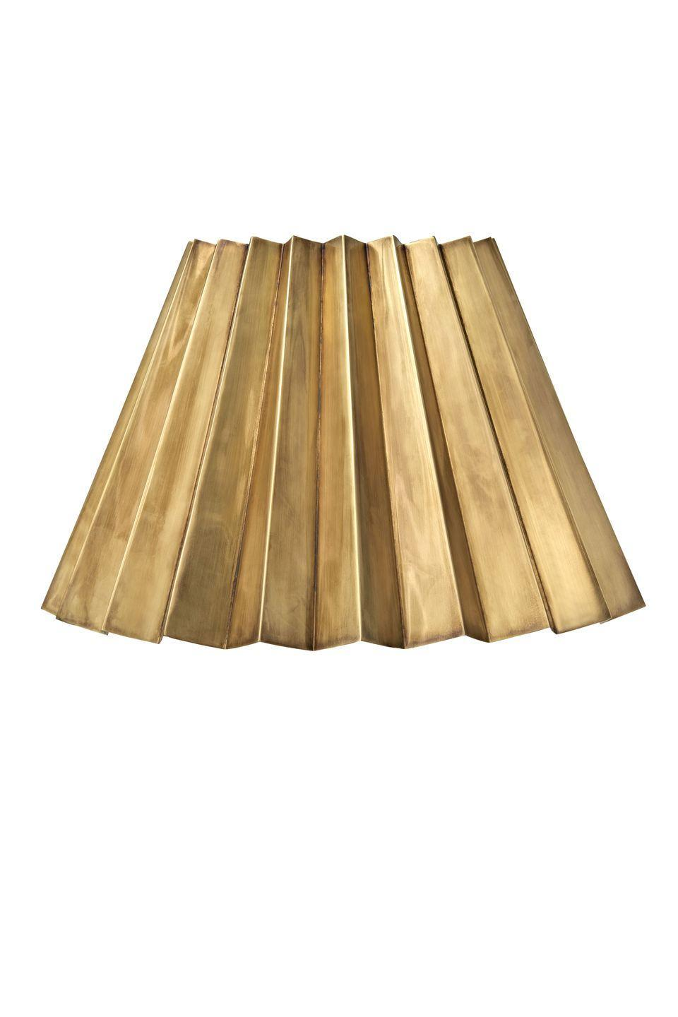 "<p><a class=""link rapid-noclick-resp"" href=""https://matildagoad.com/collections/lighting/products/brass-concertina-lampshade-small-1"" rel=""nofollow noopener"" target=""_blank"" data-ylk=""slk:SHOP NOW"">SHOP NOW</a></p><p>Following the sell-out success of her signature raffia lampshade, Matilda Goad has launched the brass concertina lampshade. Available in two sizes, it'll add a sense of glamour. </p><p>Small concertina lampshade, £175, <a href=""https://matildagoad.com/collections/lighting/products/brass-concertina-lampshade-small-1"" rel=""nofollow noopener"" target=""_blank"" data-ylk=""slk:Matilda Goad"" class=""link rapid-noclick-resp"">Matilda Goad</a></p>"