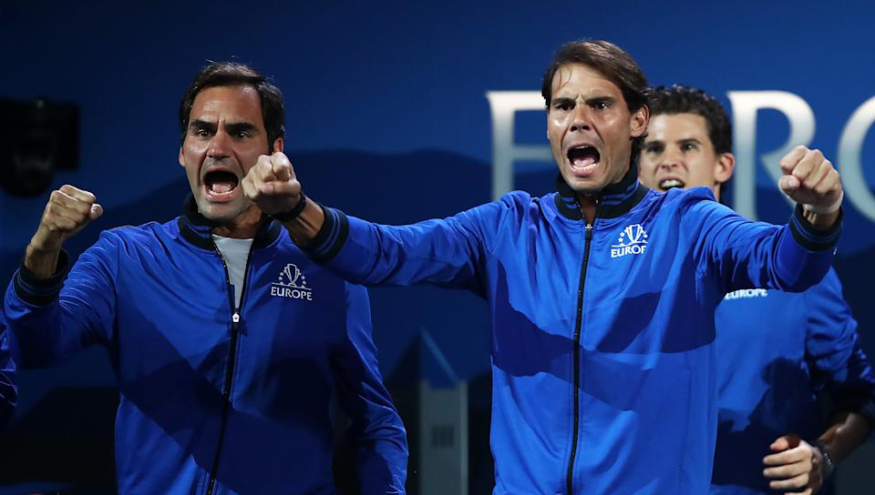 Rafael Nadal and teammate Roger Federer celebrating during a singles match at the Laver Cup in 2019.