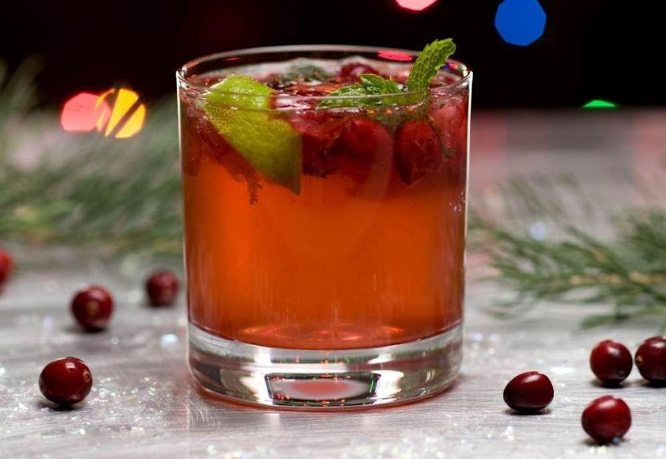 """<p><strong>Ingredients:</strong></p><p>¼ cup fresh cranberries (approximately 8)<br>5 fresh mint leaves<br>1 lime wedge (lime cut into 6 pieces)<br>1 teaspoon brown sugar<br>5 ounces ginger ale<br>Additional mint leaves for garnish (optional)</p><p><strong>Directions:</strong></p><p>Place cranberries, mint, lime, and sugar into a cocktail shaker. Using a muddling stick (or the back of a tablespoon), muddle the mixture until the cranberries are slightly crushed and the mint is bruised. Add ice and shake for approximately 10 seconds. Place the mixture into a rocks glass with ice and add ginger ale. You can add fresh mint leaves as a garnish. </p><p><em>Courtesy of <a href=""""https://blog.ciachef.edu/3-best-holiday-mocktail-drink-recipes-cia/"""" rel=""""nofollow noopener"""" target=""""_blank"""" data-ylk=""""slk:The Culinary Institute of America"""" class=""""link rapid-noclick-resp"""">The Culinary Institute of America</a>.</em></p>"""