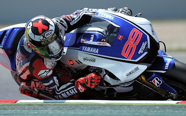 Yamaha Factory Racing's Spanish Jorge Lorenzo rides at the Catalunya racetrack in Montmelo, near Barcelona, on June 1, 2012, after the MotoGP second training session of the Catalunya Moto GP Grand Prix. AFP PHOTO/LLUIS GENELLUIS GENE/AFP/GettyImages