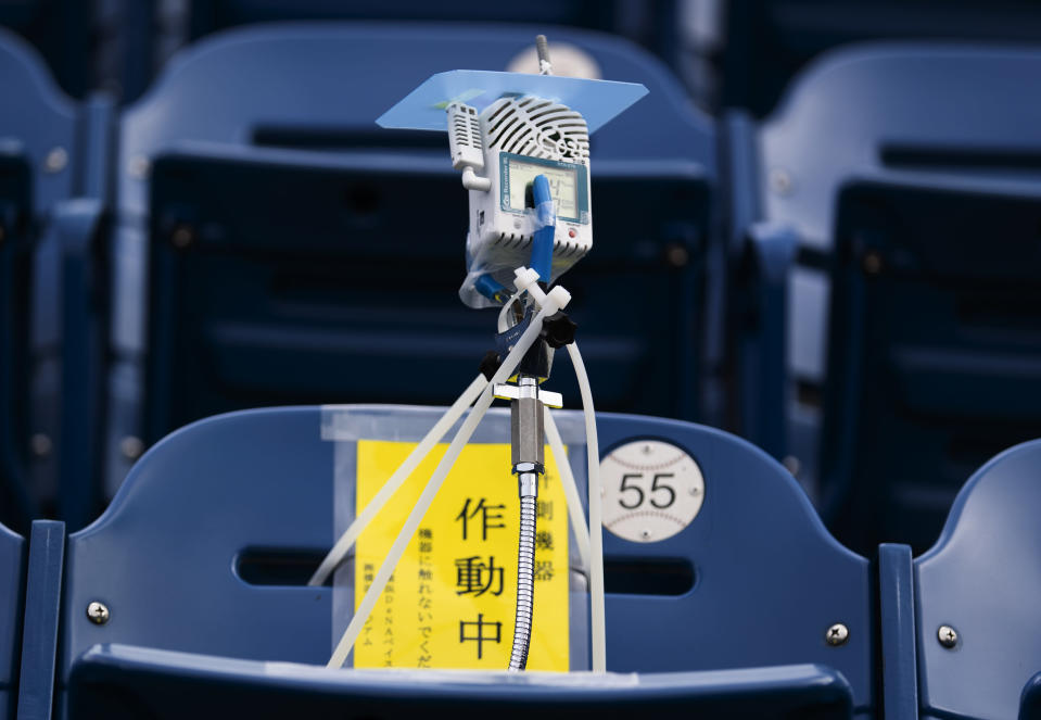 This photo shows a device to detect carbon dioxide installed in the seats of a baseball stadium, home for the Yokohama DeNA BayStars, in Yokohama, south of Tokyo on Friday, Oct. 30, 2020. The device was introduced during a media tour Friday. (AP Photo/Hiro Komae)