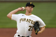 Pittsburgh Pirates starting pitcher Mitch Keller delivers during the first inning of the team's baseball game against the Chicago Cubs in Pittsburgh, Saturday, April 10, 2021. (AP Photo/Gene J. Puskar)