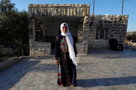 Muftia, the grandmother of U.S. congresswoman Rashida Tlaib, poses for a photo in front of her house in the village of Beit Ur Al-Fauqa in the Israeli-occupied West Bank