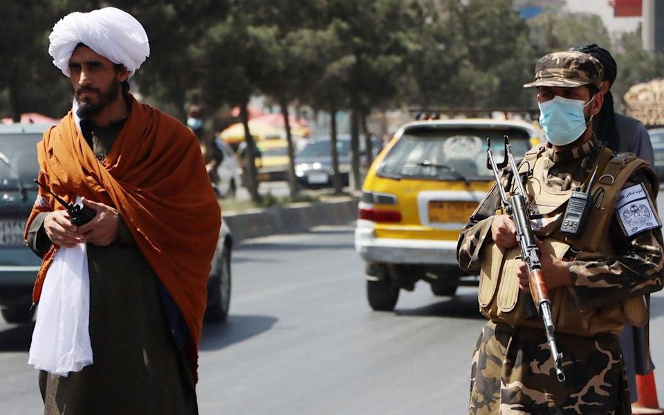 Taliban forces stand guard at a roadside checkpoint in Kabul - STRINGER/EPA-EFE/Shutterstock