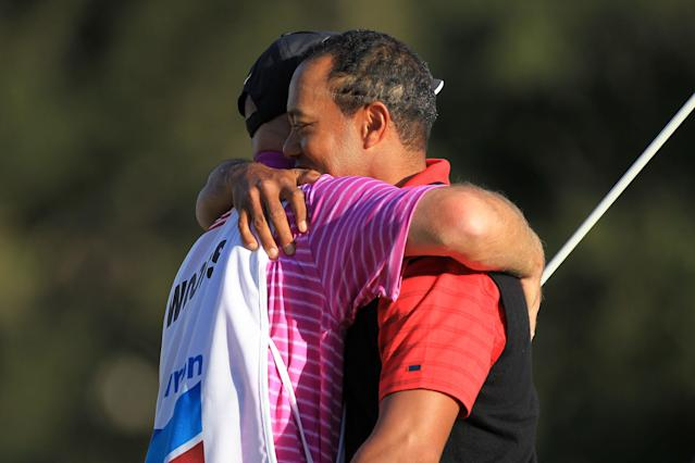 THOUSAND OAKS, CA - DECEMBER 04: Tiger Woods hugs his caddie Joe Lacava on the 18th hole after winning the Chevron World Challenge at Sherwood Country Club on December 4, 2011 in Thousand Oaks, California. Woods finished at 10 under par to beat Zach Johnson by one stroke. (Photo by Scott Halleran/Getty Images)
