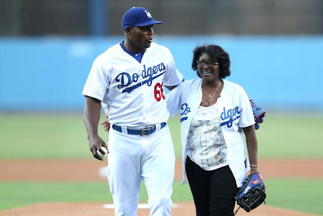 "<a class=""link rapid-noclick-resp"" href=""/mlb/players/9341/"" data-ylk=""slk:Yasiel Puig"">Yasiel Puig</a> and his mother, Maritza Valdes, have a life again together in Los Angeles. (Getty Images)"