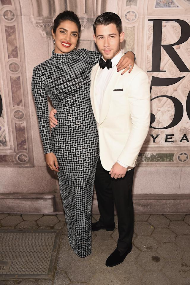 <p>The engaged couple put on their finest attire for the historic fashion show. <em>[Photo: Getty]</em> </p>