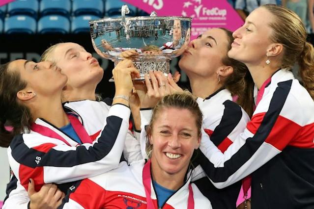 Team France celebrate their victory in the Fed Cup final tennis competition after beating Australia in the final (AFP Photo/Tony Ashby)