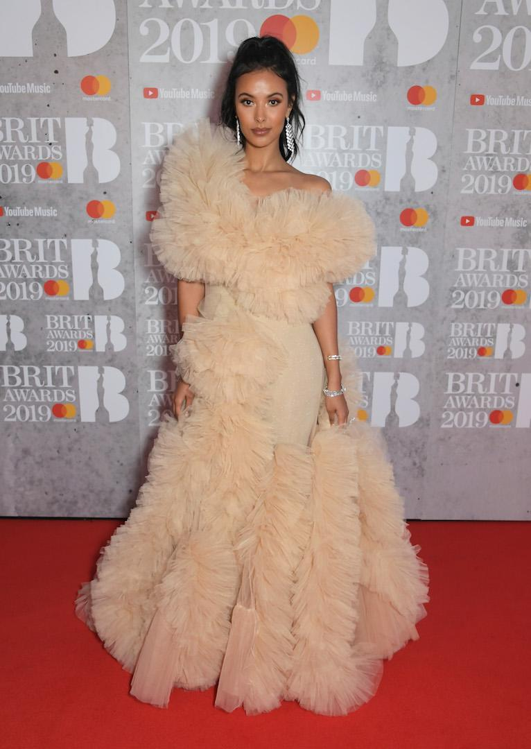 <p>Wearing a frothy tulle dress. <em>[Photo: Getty]</em> </p>